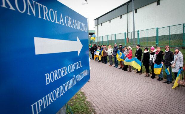 українці на кордоні з Польщею, Reuters