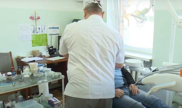 стоматолог, скриншот из видео