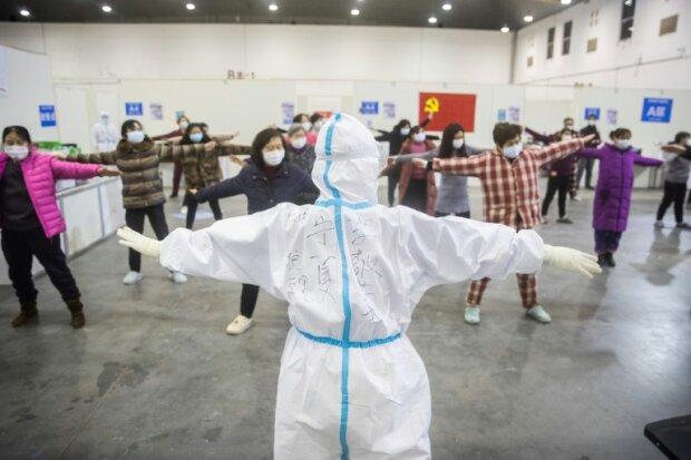 Эпидемия коронавирус, фото: AFP / STR