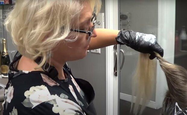 перукар, скріншот з відео