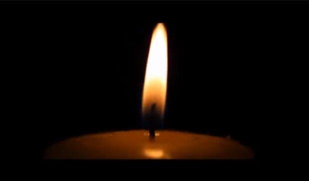 Траурная свеча, кадр из видео
