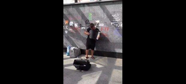 Уличный музыкант, скриншот: Youtube
