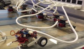 Роботи-мурахи пересувають автомобілі (відео)  413bde5c8085c