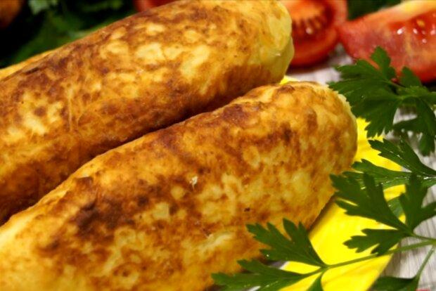 Сосиски в картофельной шубке, скриншот: YouTube