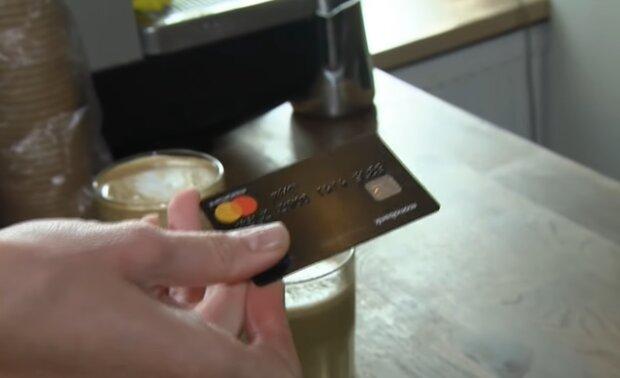 Оплата банковской карточкой, скриншот: YouTube
