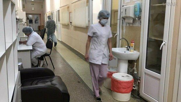 Муки заражених китайським коронавірусом показали в деталях: дикі крики ізольованих людей, відео