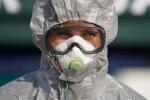 Коронавірус, захисний костюм, фото: Getty Images