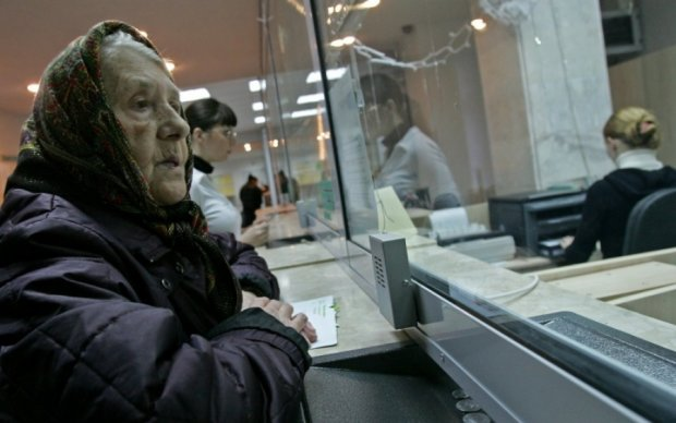 Украинцы будут переплачивать за коммуналку еще и Ощадбанку