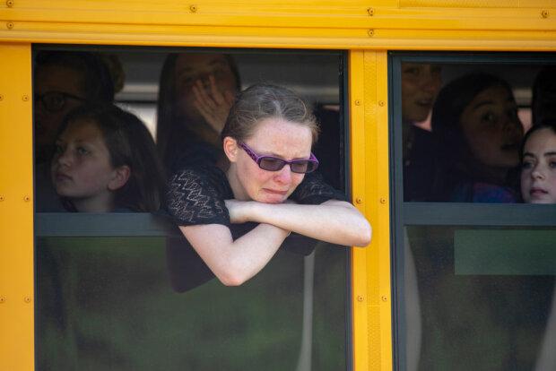 школярка в автобусі, фото GettyImages