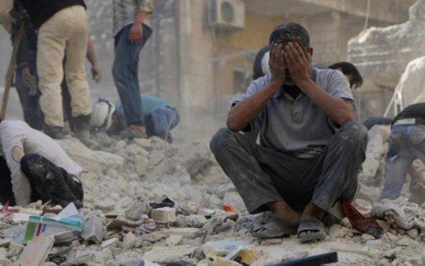 В Сирии взорвался склад с оружием, десятки погибших: фото 18+
