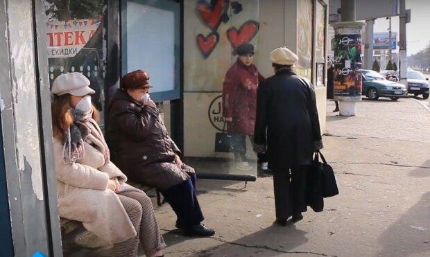 у масці, скріншот з відео
