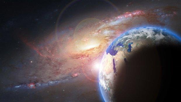 к Земле приближается темная материя