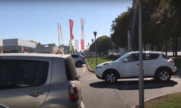 автомобили, скриншот из видео