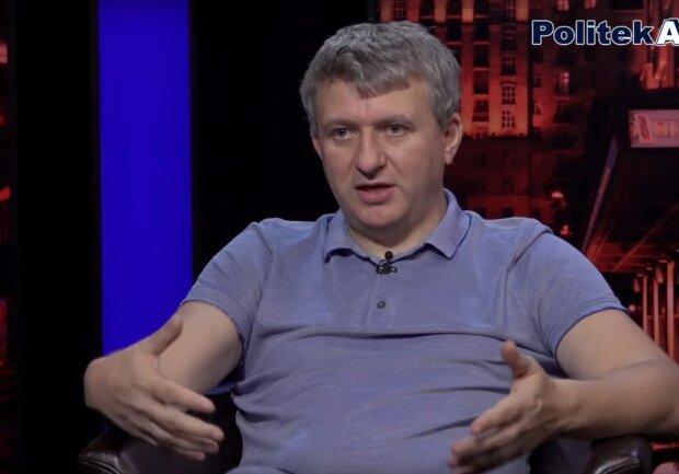 политолог Юрий Романенко