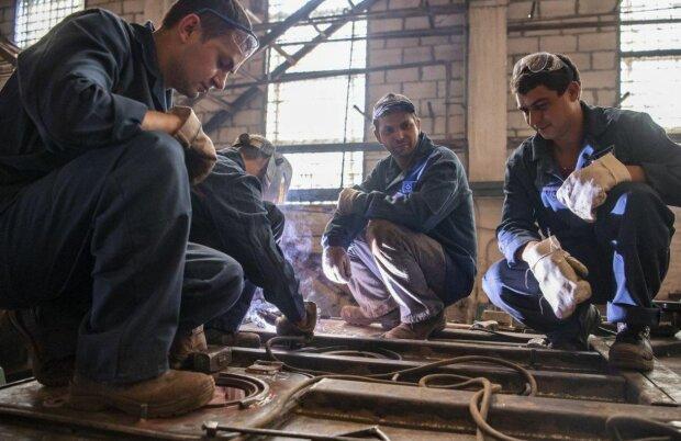 Робітники, фото: Unian