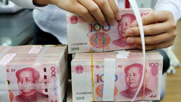 Китай залишиться без грошей через коронавірус, готівку масово знищують