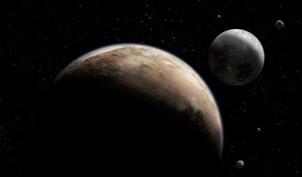 На Землю передали перші знімки Плутона