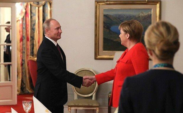 Путин и Меркель, Delo.ua