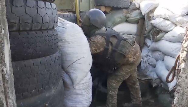 Военный на ООС, скриншот с YouTube