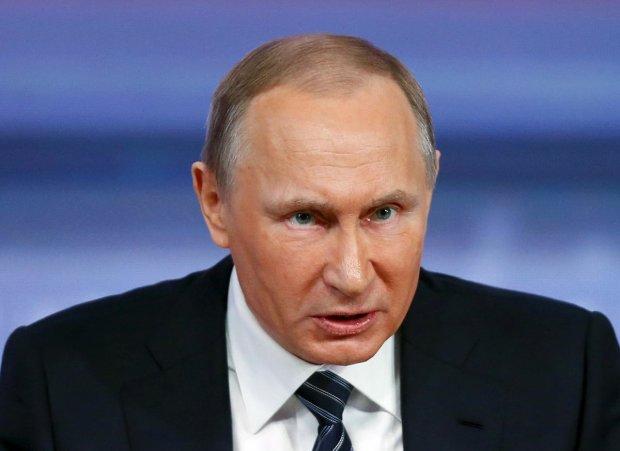 В.Путін