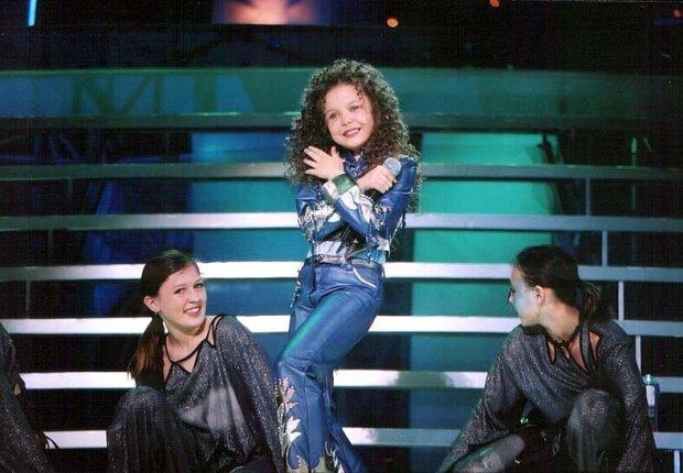 На першому пісенному конкурсі Аліна перемогла в три роки