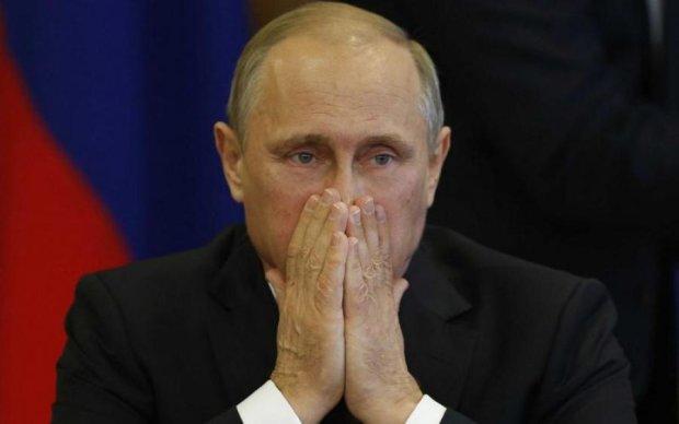 Под Киевом задержали грабителей с визиткой Путина