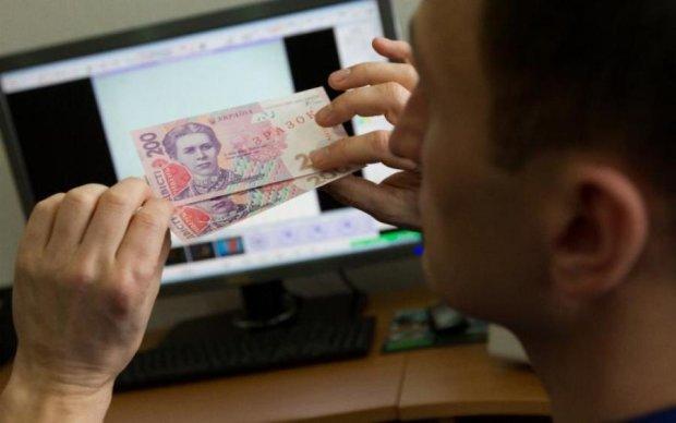 Популярный сервис предлагает украинцам прикупить фальшивых гривен