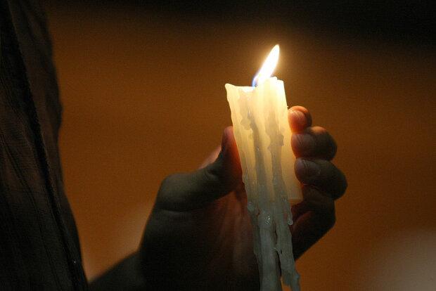 Свеча скорби фото: Getty Images