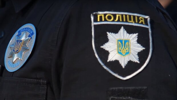 полицейский, скриншот из видео