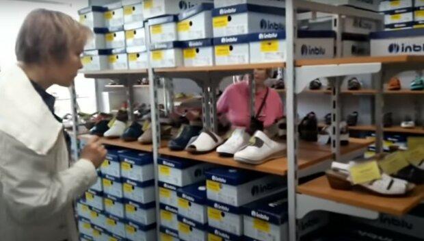 Взуттєвий магазин, скріншот з відео