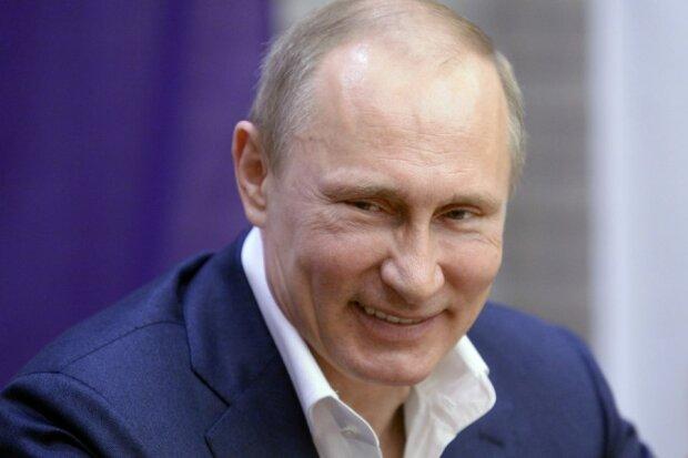 Путін, фото - Quartz