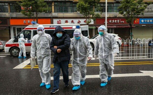 Нагорода за донос: в Китаї борються з коронавірусом сталінськими методами