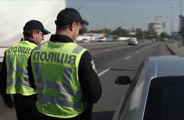 Поліція, кадр з відео