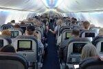 У літаку, фото - Los Angeles Times